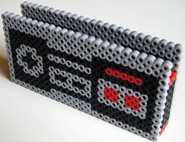 NES korthållare